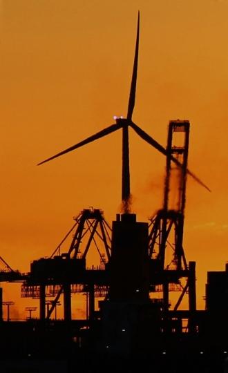 Hamburg Hafen sunset on cranes and windmill