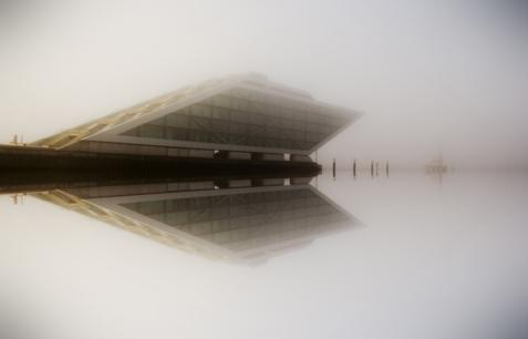 Hamburg Altona - Mirror Dockland building in fog